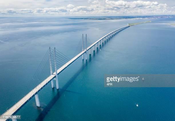 øresund, öresund bridge connecting sweden with denmark - oresund region stock pictures, royalty-free photos & images