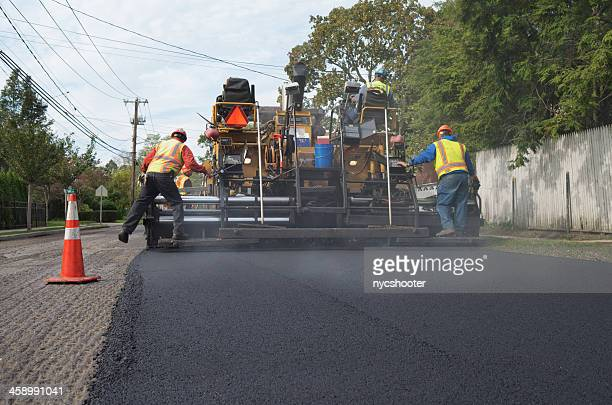 resurfacing asphalt road - asphalt paving stock photos and pictures