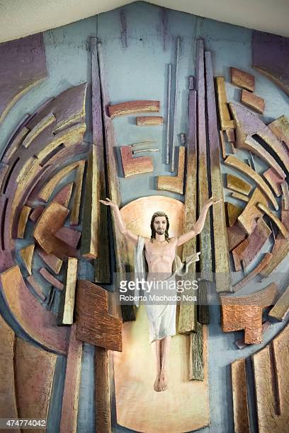 Resurrected Jesus Christ statue in catholic church traditionally Jesus was represented nailed to the cross but this church chooses to show him...