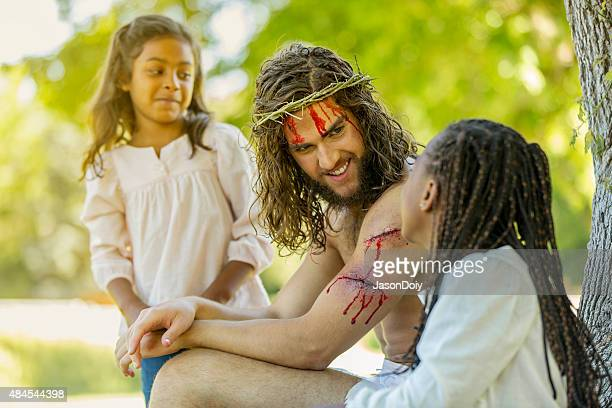 resurrected jesus talking with children - eternity stock pictures, royalty-free photos & images
