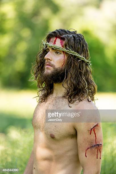 resurrected jesus wearing a crown of thorns - jesus blood stock pictures, royalty-free photos & images