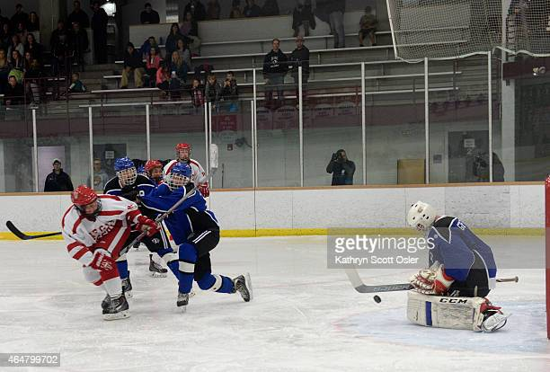 Resurrection's goalie Dylan Griffith stops a goal in the third period The Regis Jesuit High School hockey team takes on Resurrection Christian High...