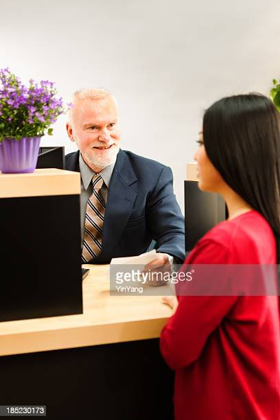 Retail Banking Bank Teller Helping Customer Over the Counter Vt