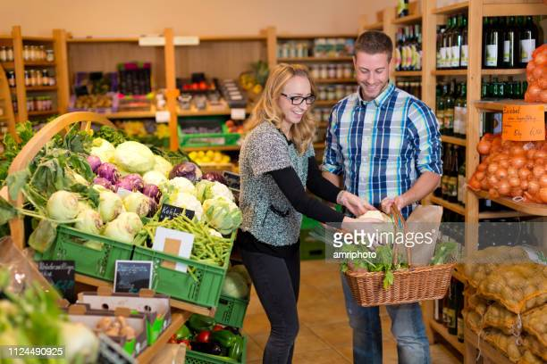 retail customer service in organic health food shop - health food shop stock pictures, royalty-free photos & images