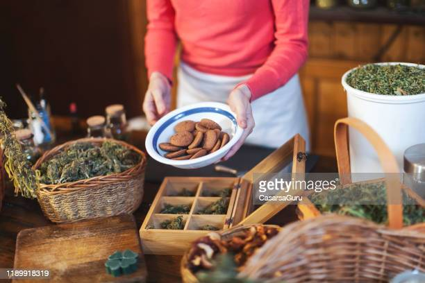 retail in cannabis store with cookies - stock photo - cannabis store stock pictures, royalty-free photos & images