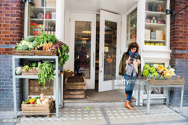 retail place selling organic produce market in urban london england - shoreditch stock photos and pictures
