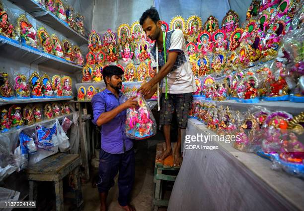 Retail seller seen displaying the idols of Laxmi & Ganesh at his store for sale ahead of the occasion of Bengali New year celebration & puja ahead...