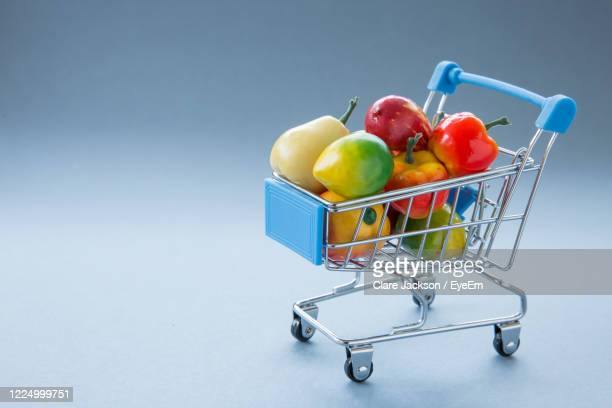 a retail shopping trolley or cart full of fresh organic fruit and vegetables concept with copy space - panic buying stock pictures, royalty-free photos & images