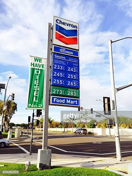 Retail signs Chevron gas station in Seal Beach California