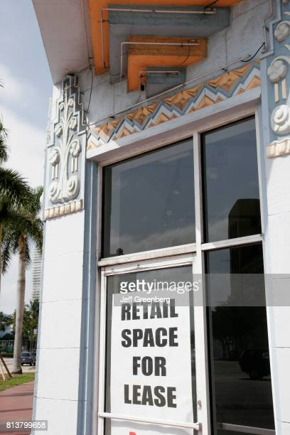 A retail space for lease sign in the window of a building on Fifth Street