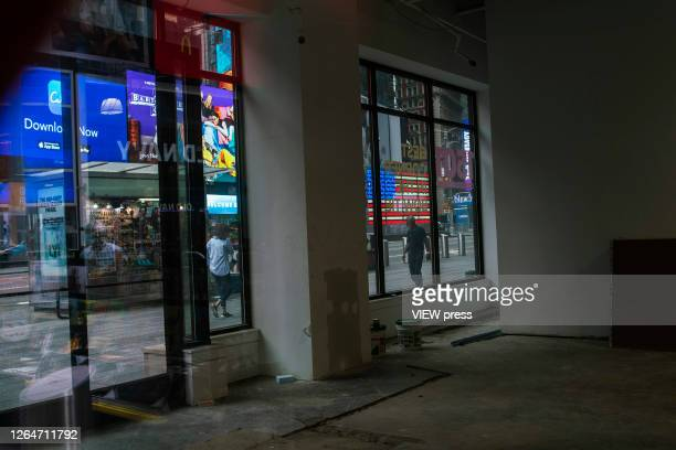 A retail store is seen closed in Times Square on August 8 2020 in New York City With more than four months NYC has closed some of their doors to...
