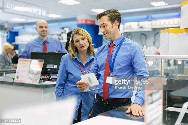 retail store manager and his team - electronics store stock photos and pictures