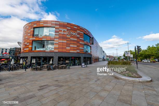 retail store next and other businesses in newport, wales - newport wales stock pictures, royalty-free photos & images
