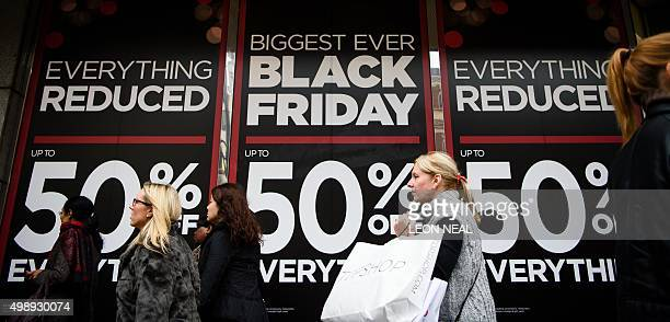 Retail stores display 'Black Friday' advertisements and banners on Oxford Street in central London as the annual retail event takes place on November...