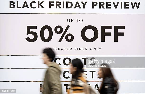 Retail stores display 'Black Friday' advertisements and banners on Oxford Street in central London on November 24 ahead of the annual retail event...