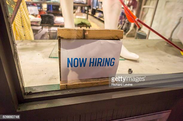 A retailer in Brooklyn in New York posts a 'Now Hiring' sign in their window The US Labor Dept announced November payrolls increased 211000 while...