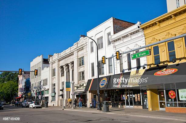 retailers on university downtown street - ann arbor stock pictures, royalty-free photos & images