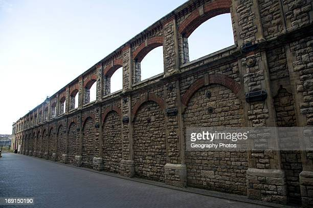 Retained wall of one of the GWR railway workshops Swindon England
