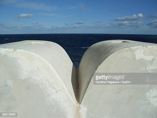retaining wall against sea and sky - carolina fragapane stock pictures, royalty-free photos & images
