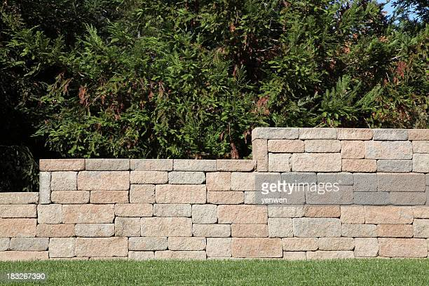 retaining wall with brick blocks - stone wall bildbanksfoton och bilder