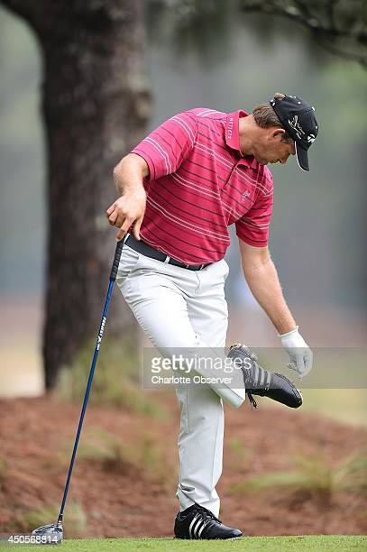Retief Goosen cleans his cleats with a golf tee in the No 2 tee box Friday June 13 2014 Players began play at Pinehurst No 2 during the second round...