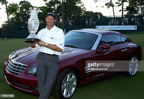 Retief Goosen holds the champion's trophy at the Chrysler Championship Sunday November 2 2003 at Palm Harbor Florida Goosen won the tournament and...