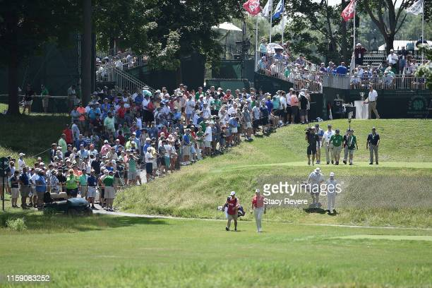 Retief Goosen of South Africa and David Toms walk off the first tee during the third round of the U.S. Senior Open Championship at the Warren Golf...
