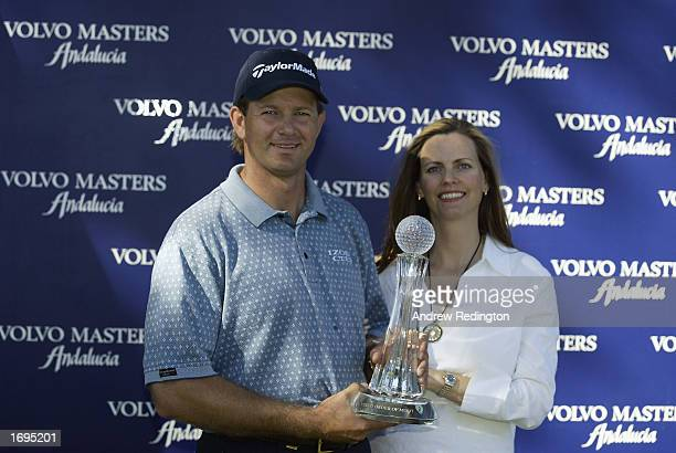 Retief Goosen of South Africa and his wife Tracy pose with the Order of Merit trophy after the Volvo Masters at the Valderrama Golf Club Andalucia...