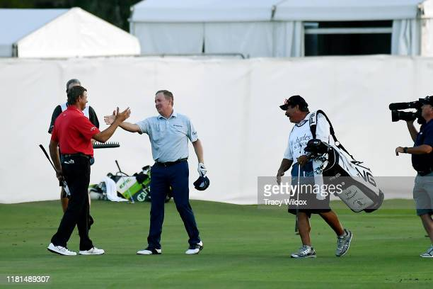 Retief Goosen of South Africa congratulates Jeff Maggert on making eagle during a playoff and winning the PGA TOUR Champions Charles Schwab Cup...