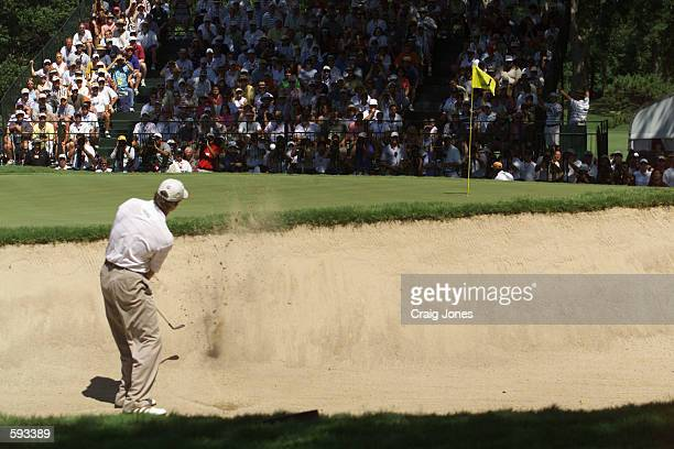 Retief Goosen of South Africa hits a shot during the Monday playoff with Mark Brooks at the 2001 US Open played at Southern Hills CC in Tulsa,...
