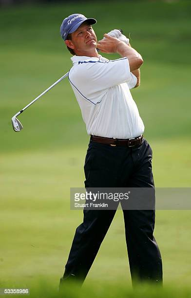 Retief Goosen of South Africa hits a shot on the 14th hole during the first round of the 2005 PGA Championship at Baltusrol Golf Club on August 11,...