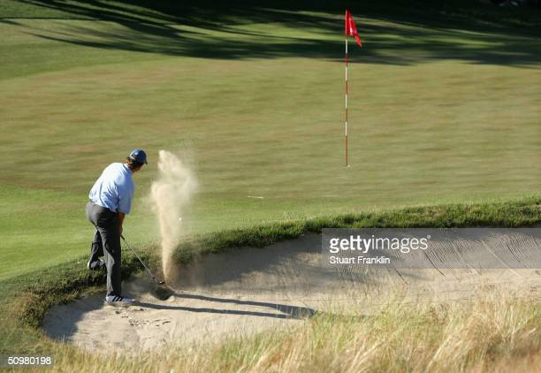 Retief Goosen of South Africa hits his bunker shot on the 14th hole during the final round of the 104th US Open June 20 2004 at Shinnecock Hills Golf...