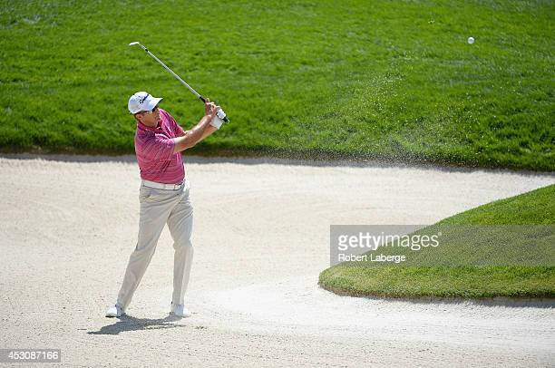 Retief Goosen of South Africa hits out of the bunker on the first hole during the third round of the Barracuda Championship at the Montreux Golf and...