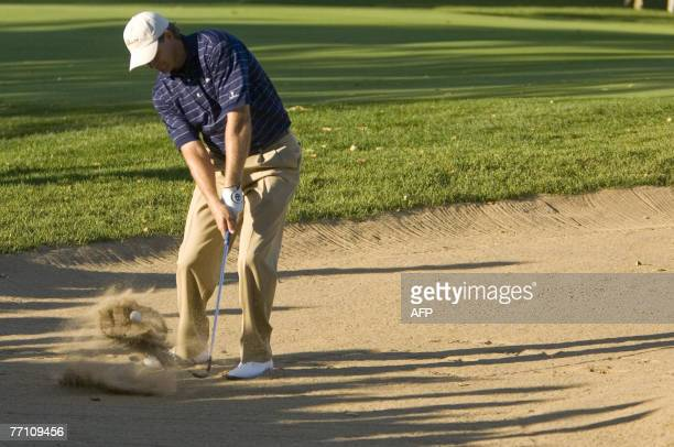 Retief Goosen of South Africa hits out of the sand on the 18th hole during Saturday afternoon's Four-Ball matches at The Royal Montreal Golf Club...