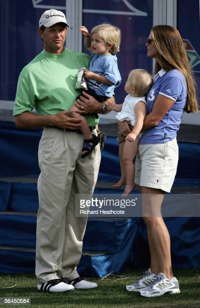 Retief Goosen of South Africa holds his son Leo James with his wife Tracy holding their daughter Ella after round four of the South African Airways...