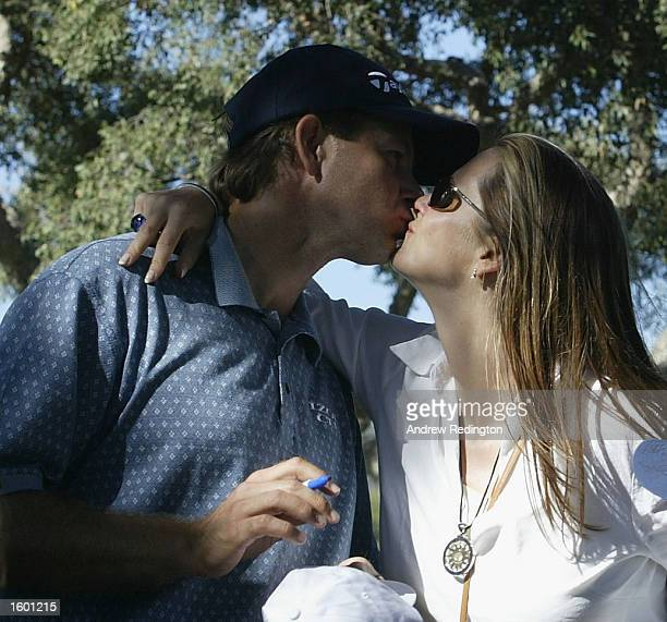 Retief Goosen of South Africa kisses his wife Tracy after winning the Order of Merit title at the Volvo Masters at the Valderrama Golf Club Andalucia...