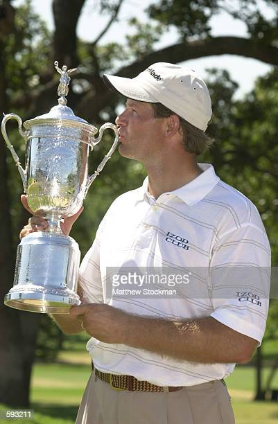 Retief Goosen of South Africa kisses the trophy after defeating Mark Brooks in a Monday playoff at the 2001 US Open played at Southern Hills CC in...