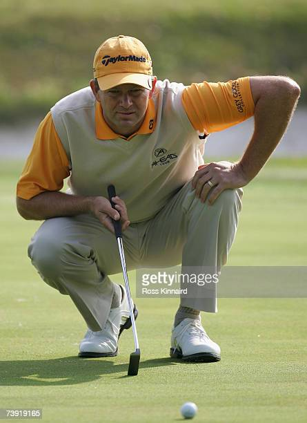 Retief Goosen of South Africa lines up his putt on the par three 12th hole during the first round of the BMW Asian Open at the Tomson Shanghai Pudong...