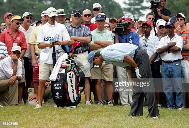 Retief Goosen of South Africa looks at his ball in the deep rough during the final round of the US Open on Pinehurst No 2 at the Pinehurst Resort on...