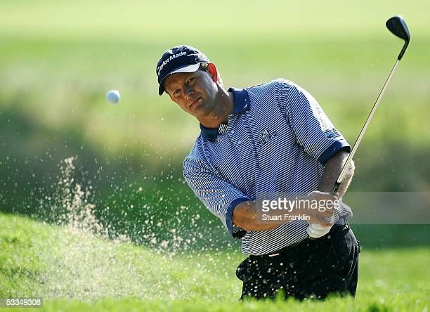Retief Goosen of South Africa plays a bunker shot during the third practice round of the 2005 PGA Championship at Baltusrol Golf Club on August 10,...