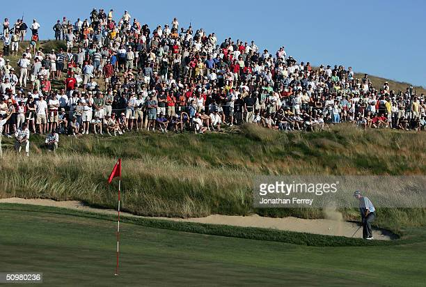 Retief Goosen of South Africa plays a bunker shot on the 14th hole during the final round of the 104th US Open at Shinnecock Hills Golf Club on June...