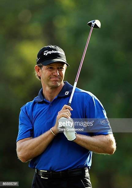 Retief Goosen of South Africa plays a shot on the 17th hole during the final round of the Transitions Championship at the Innisbrook Resort and Golf...
