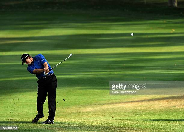 Retief Goosen of South Africa plays a shot on the 18th hole during the final round of the Transitions Championship at the Innisbrook Resort and Golf...