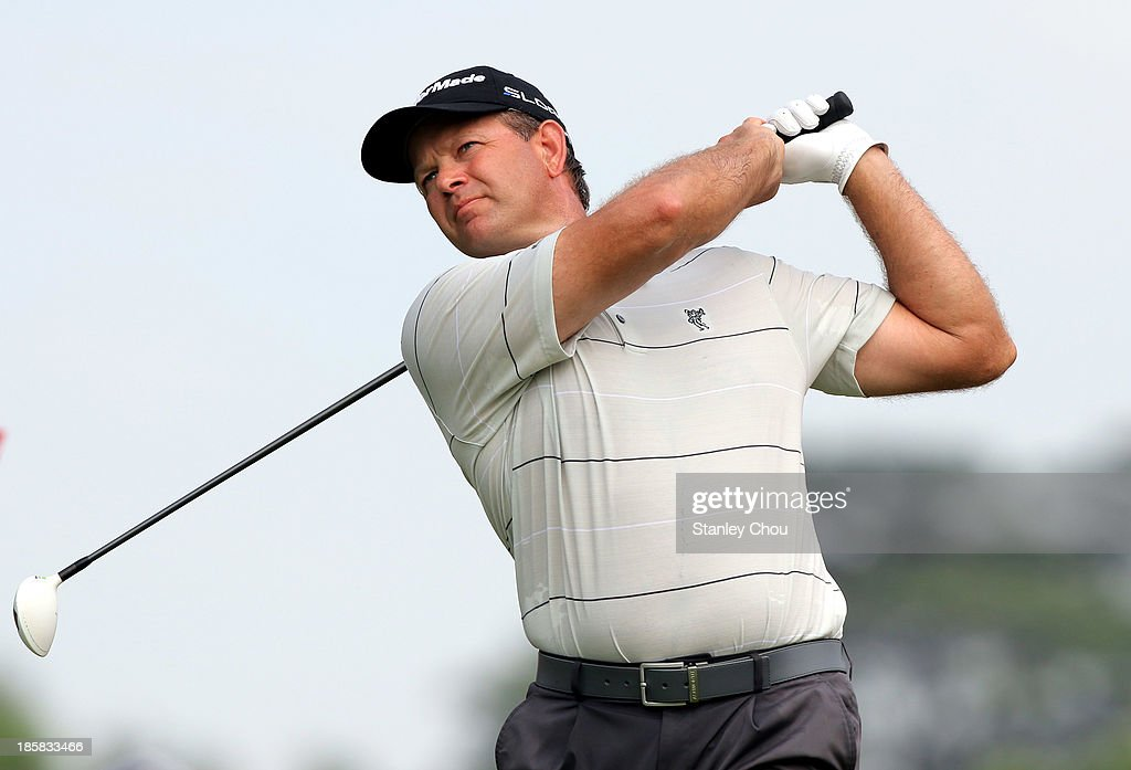 Retief Goosen of South Africa plays a tee shot on the 18th hole during round two of the CIMB Classic at Kuala Lumpur Golf & Country Club on October 25, 2013 in Kuala Lumpur, Malaysia.