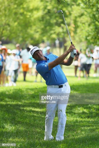 Retief Goosen of South Africa plays his second shot on the 7th hole during day three of the BMW South African Open Championship at Glendower Golf...