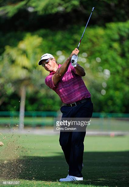 Retief Goosen of South Africa plays his second shot to 8th green during the third round of the Sony Open in Hawaii at Waialae Country Club on January...