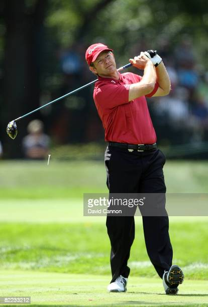 Retief Goosen of South Africa plays his tee shot on the sixth hole during round three of the 90th PGA Championship at Oakland Hills Country Club on...