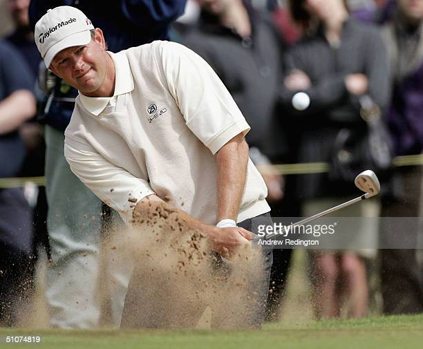 Retief Goosen of South Africa plays out of a bunker on the 16th hole during the second round of the 133rd Open Championship at the Royal Troon Golf...