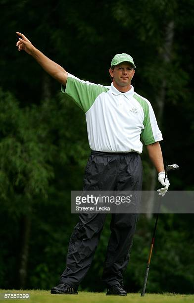 Retief Goosen of South Africa points after a stray tee shot on the 5th hole during the final round of the Wachovia Championship on May 7, 2006 at...