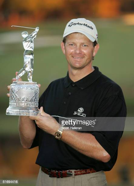Retief Goosen of South Africa poses with the trophy after a fourstroke victory at the PGA Tour Championship at East Lake Golf Club on November 7 2004...